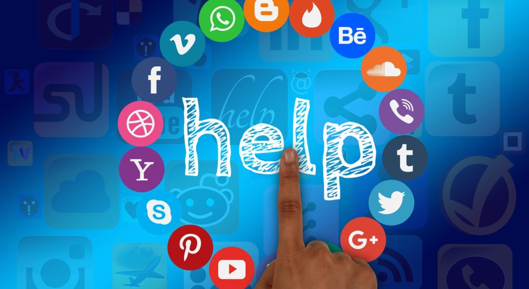 finger pointing to word help surrounded by social media icons